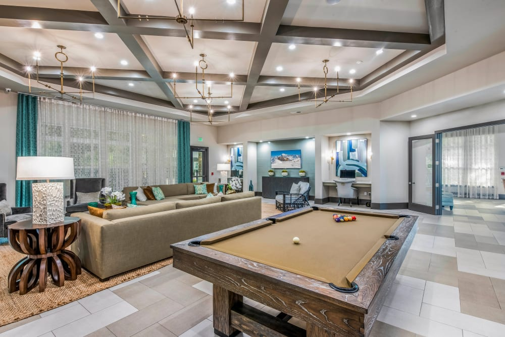 Billiards table and more in the clubhouse game room at Canopy at Citrus Park in Tampa, Florida