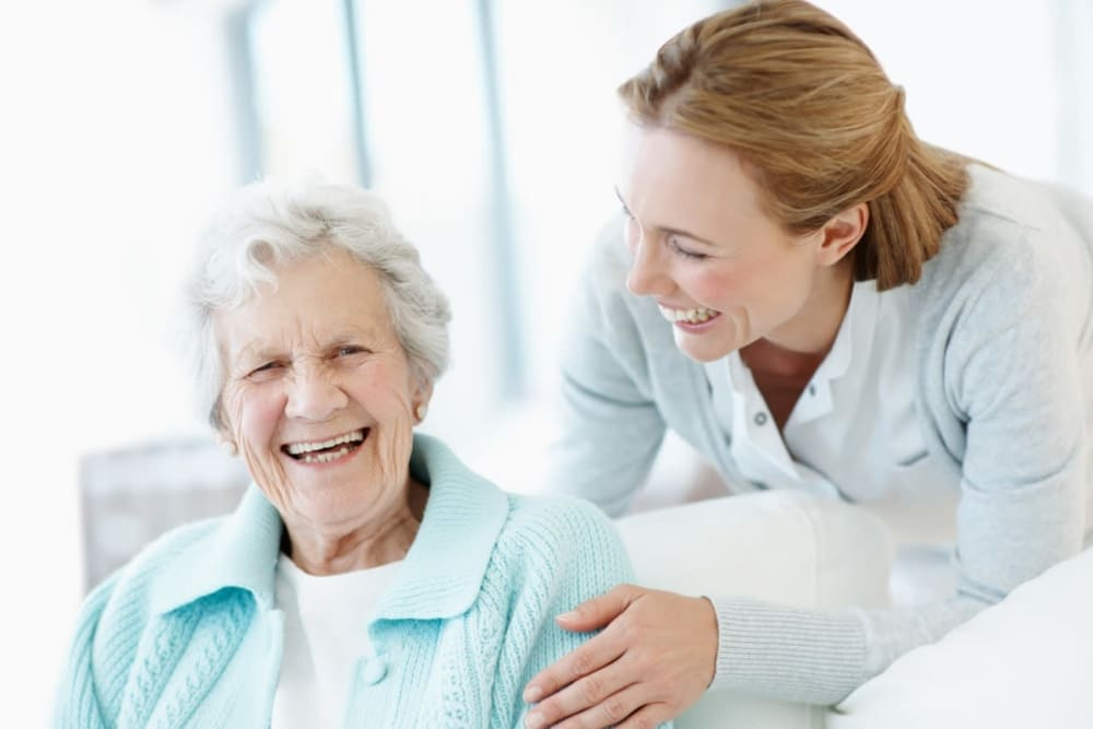 Staff member with resident in assisted living apartment at Courtyard Estates at Cedar Pointe in Pleasant Hill, Iowa.