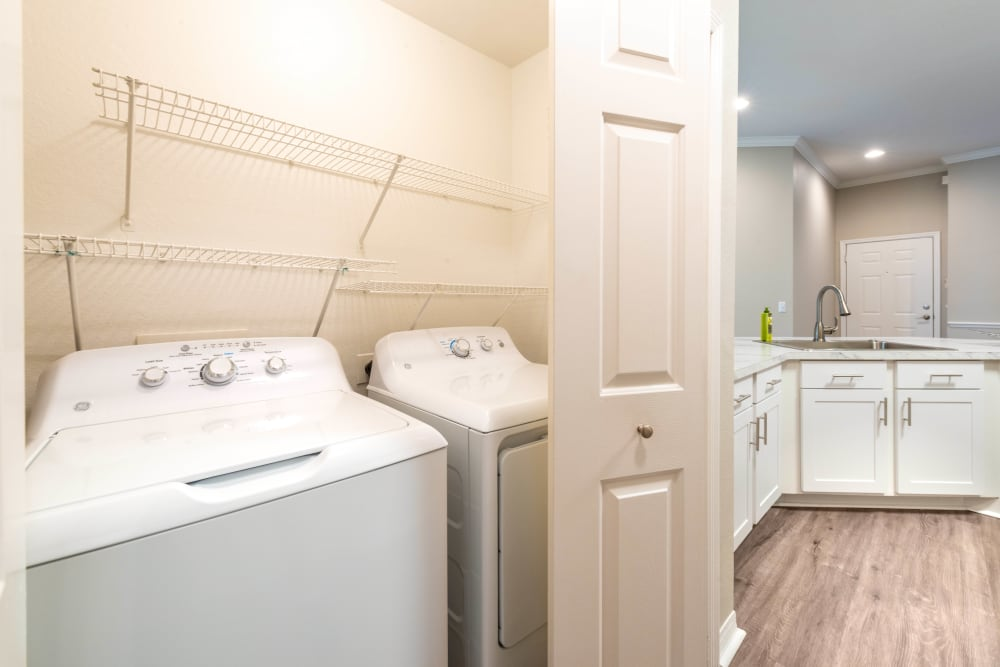 In-unit washer and dryer in a model apartment home at Cape House in Jacksonville, Florida