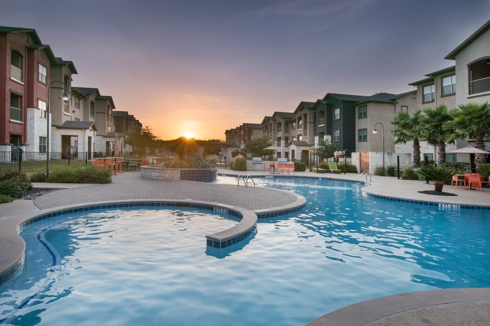 Gorgeous resort-style swimming pool at sundown at Carrington Oaks in Buda, Texas