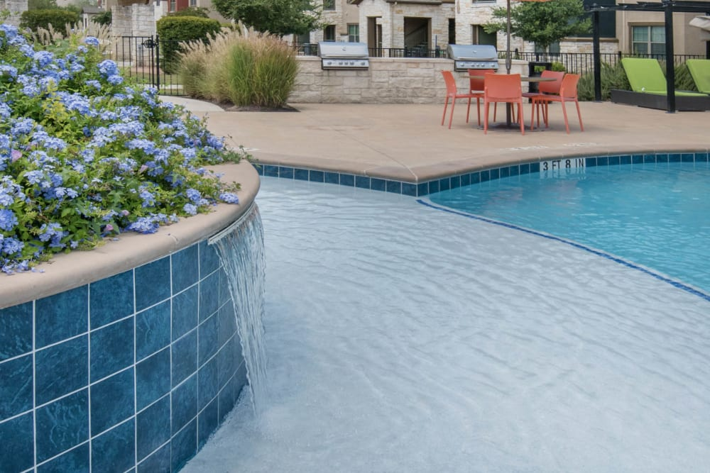 Sun deck in the pool at Carrington Oaks in Buda, Texas