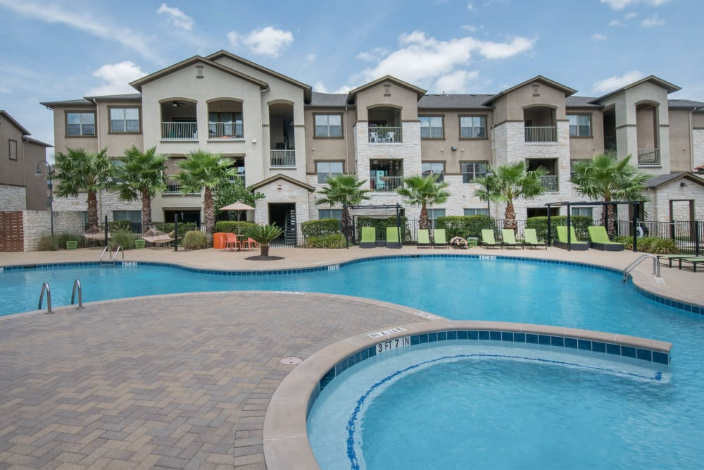 Large resort-style swimming pool at Carrington Oaks in Buda, Texas