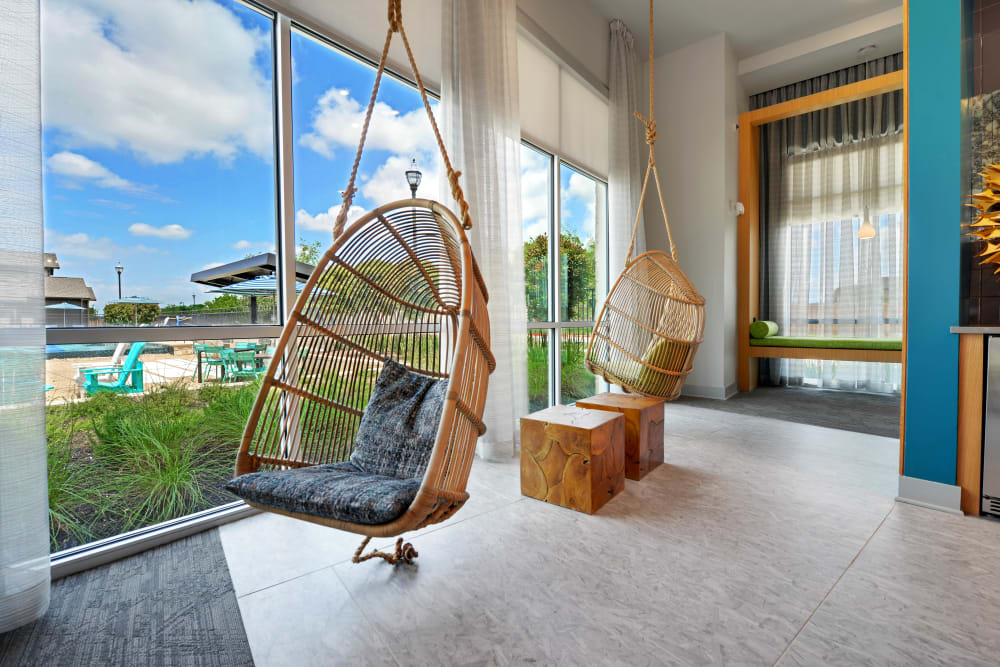 Hanging wicker swing chairs in the clubhouse at Carrington Oaks in Buda, Texas