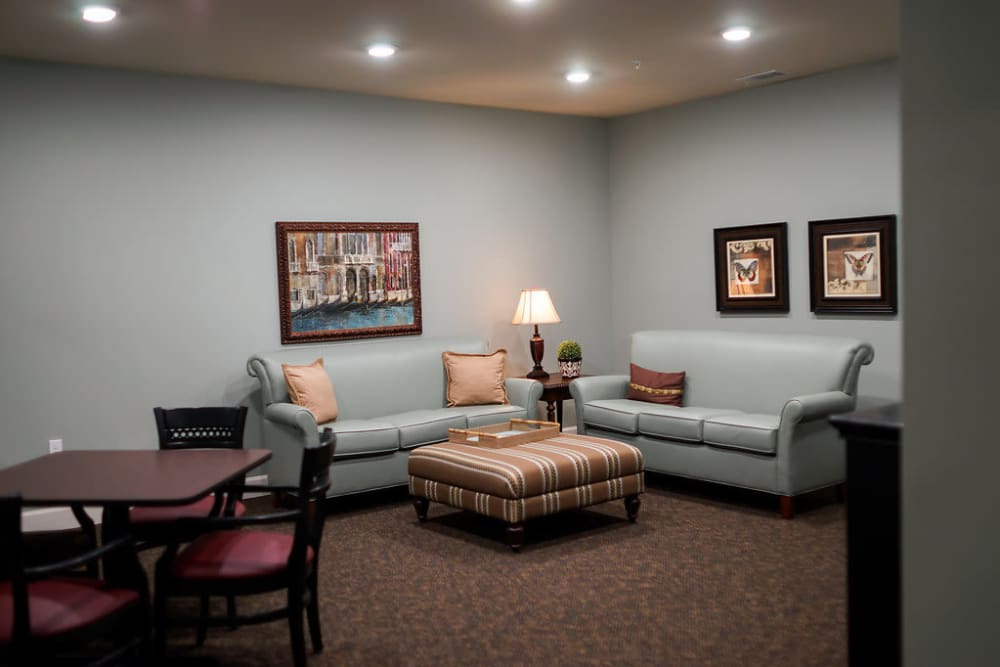 Visiting area at the end of a hall at The Claiborne at Hattiesburg Independent Living in Hattiesburg, Mississippi