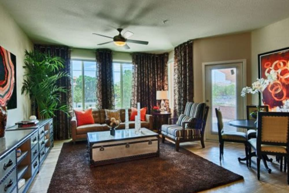 Ceiling fan and hardwood flooring in a model apartment's living area at Elevation Chandler in Chandler, Arizona