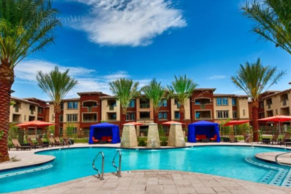 Resort-style swimming pool on a beautiful day at Elevation Chandler in Chandler, Arizona