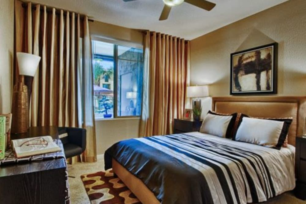 Well-decorated master bedroom in a model home at Elevation Chandler in Chandler, Arizona