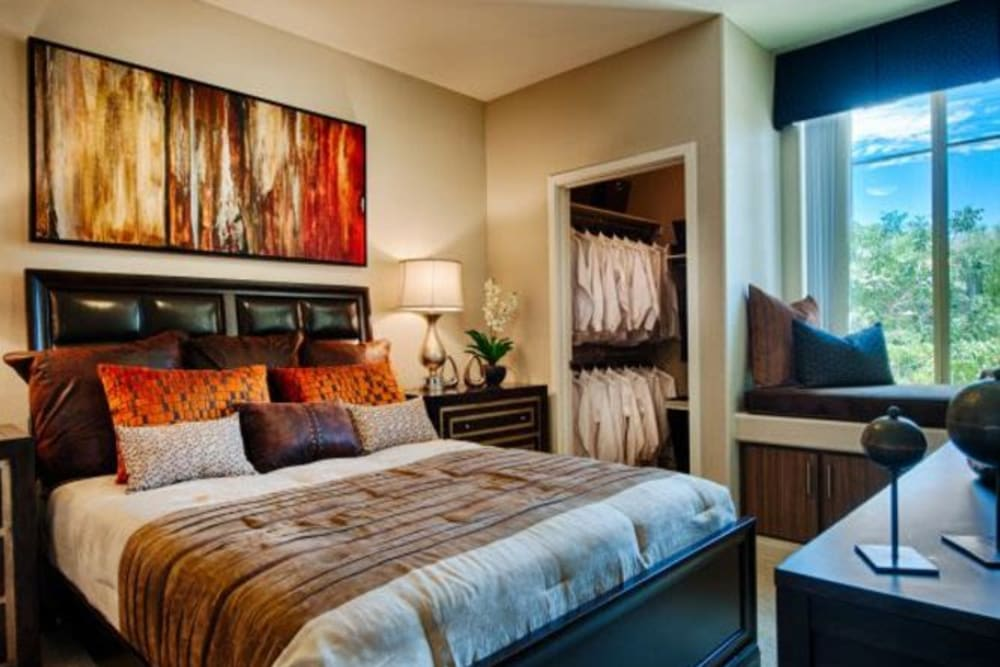 Modern furnishings and decor in the master bedroom of a model apartment home at Elevation Chandler in Chandler, Arizona