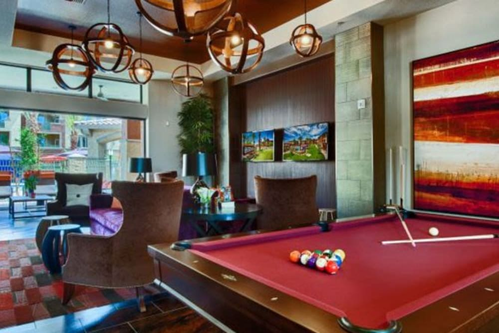 Game room with billiards and more in the clubhouse at Elevation Chandler in Chandler, Arizona