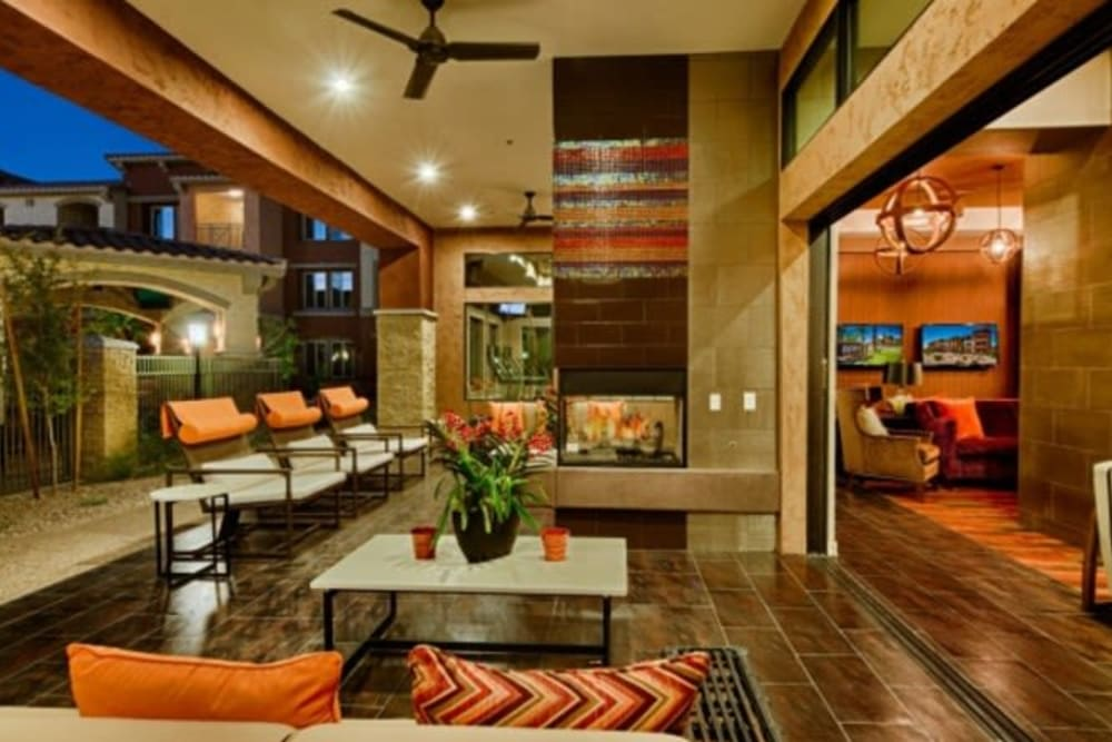 Open-air lounge area at dusk at Elevation Chandler in Chandler, Arizona