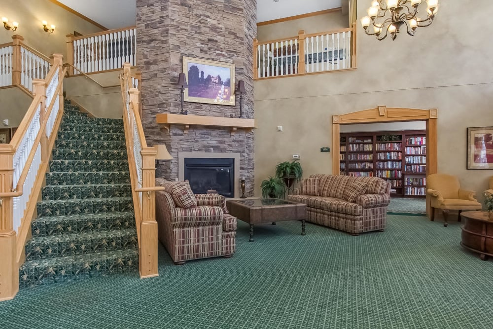 Main lobby with a grand staircase at Applewood Pointe of Bloomington in Bloomington, Minnesota.