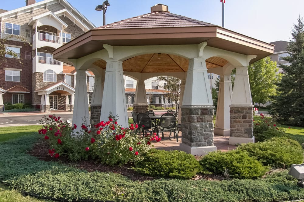 A gazebo with flowers at Applewood Pointe of Bloomington in Bloomington, Minnesota.