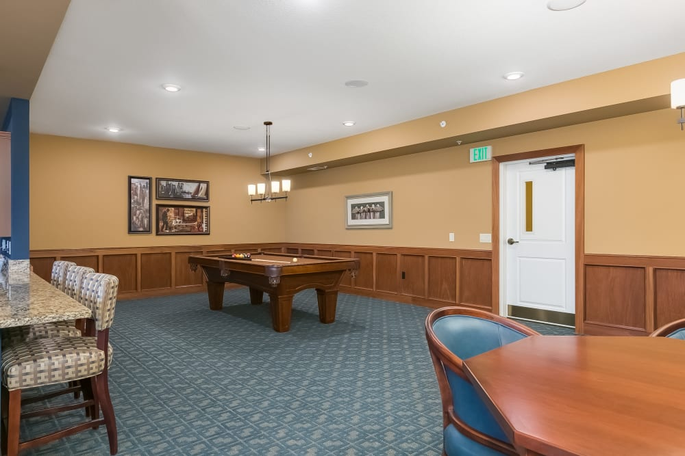 Game room with pool table at Applewood Pointe Bloomington at Valley West in Bloomington, Minnesota.