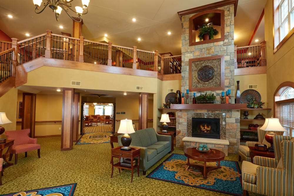 Large lobby with fireplace at Applewood Pointe Bloomington at Valley West in Bloomington, Minnesota.