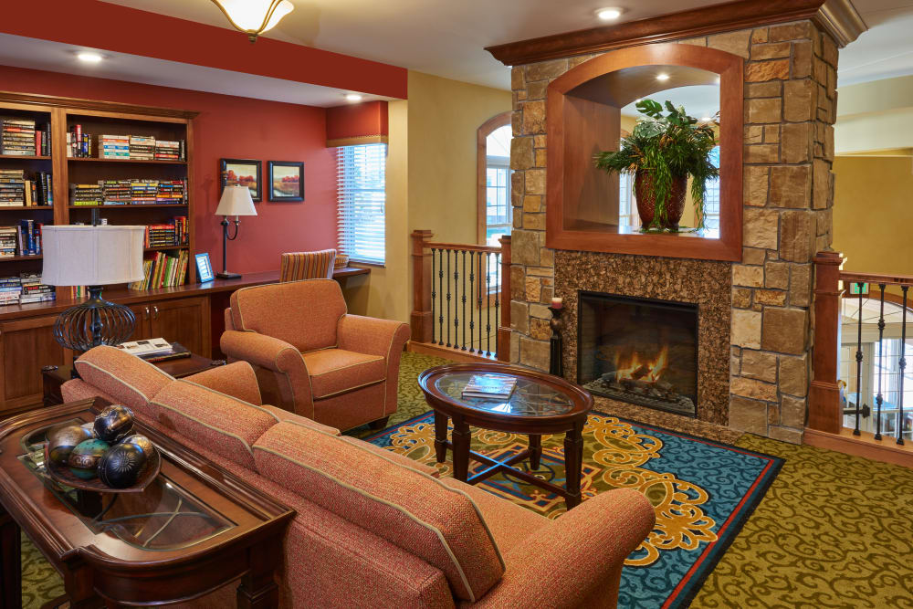 Lounge with a fireplace at Applewood Pointe Bloomington at Valley West in Bloomington, Minnesota.