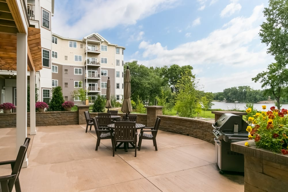 Outside deck with a grill at Applewood Pointe Champlin in Champlin, Minnesota.