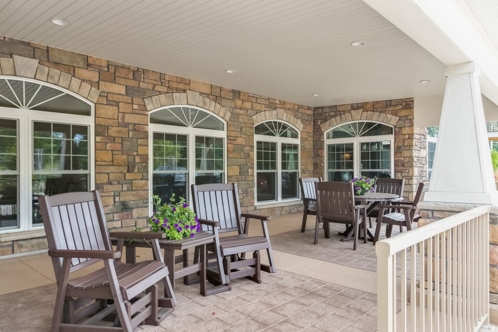 Porch with chairs at Applewood Pointe Champlin in Champlin, Minnesota.