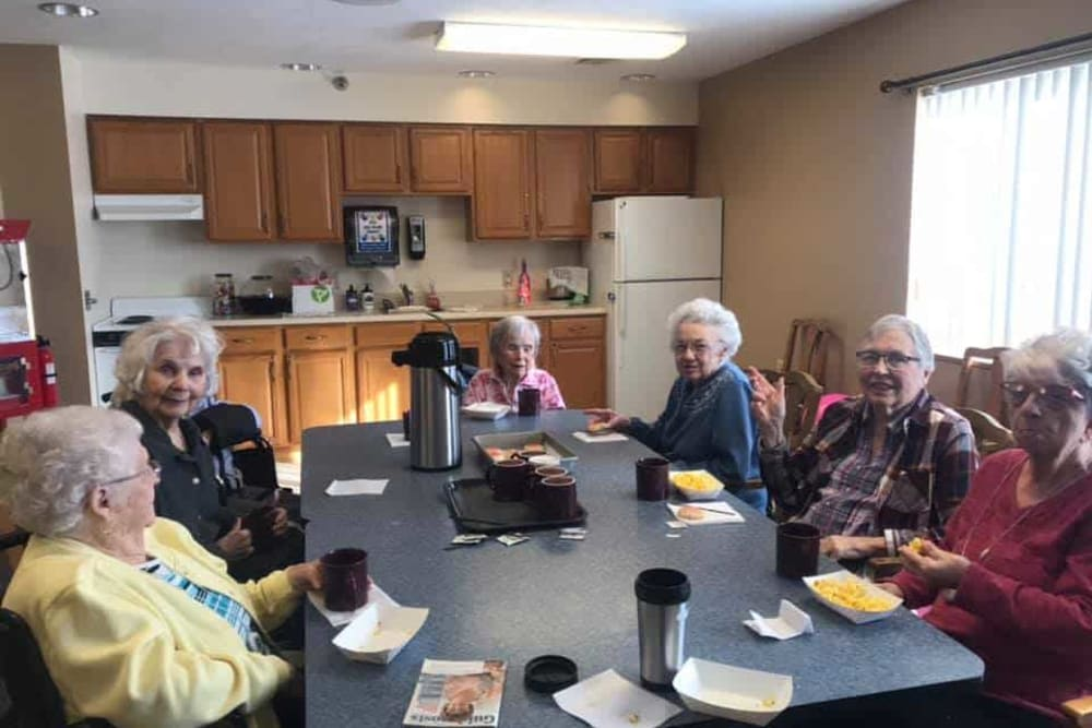 Residents enjoy coffee social hour at Lawton Senior Living in Lawton, Iowa.