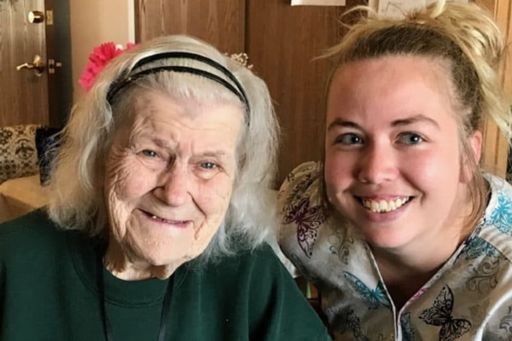 Resident and granddaughter visiting at Lawton Senior Living in Lawton, Iowa.