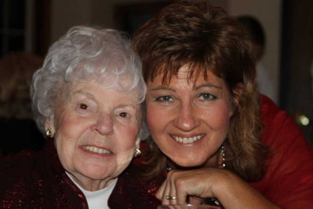 Family member joins resident for holiday celebration at Lawton Senior Living in Lawton, Iowa.