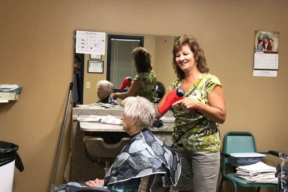 Resident having hair done in styling salon at Lawton Senior Living in Lawton, Iowa
