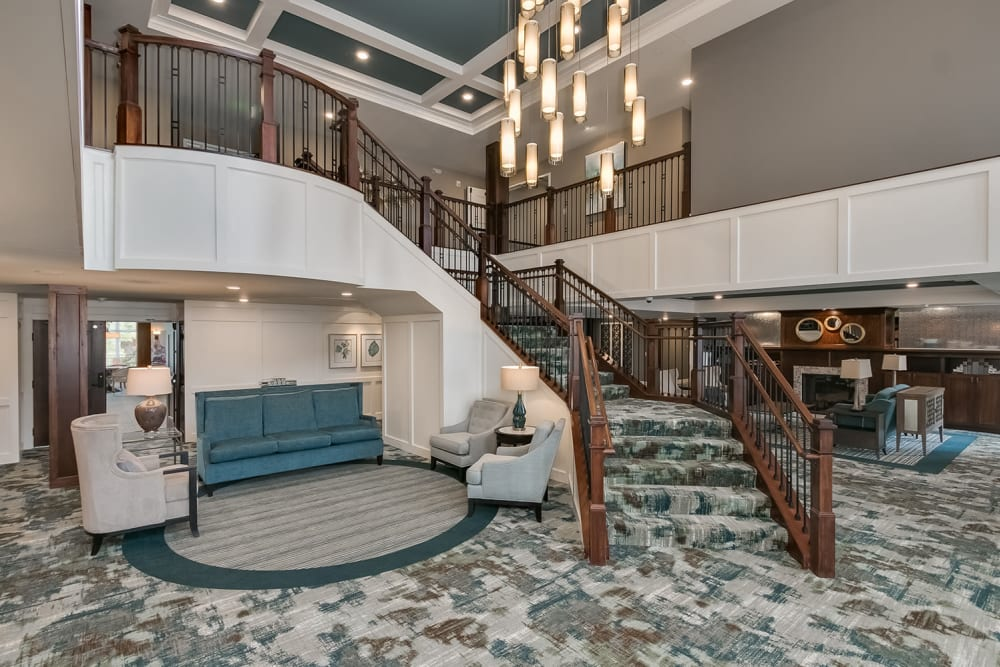 Lobby with a grand staircase at Applewood Pointe Eagan in Eagan, Minnesota.