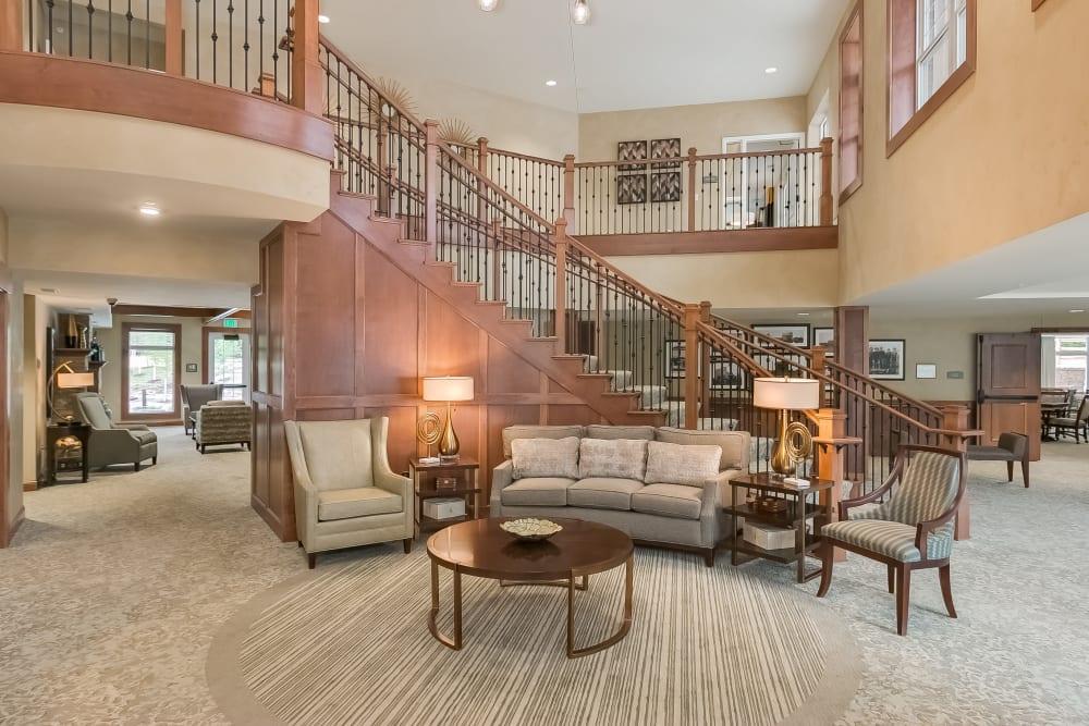 Lobby with grand staircase at Applewood Pointe of Minnetonka community in Minnetonka,  Minnesota.