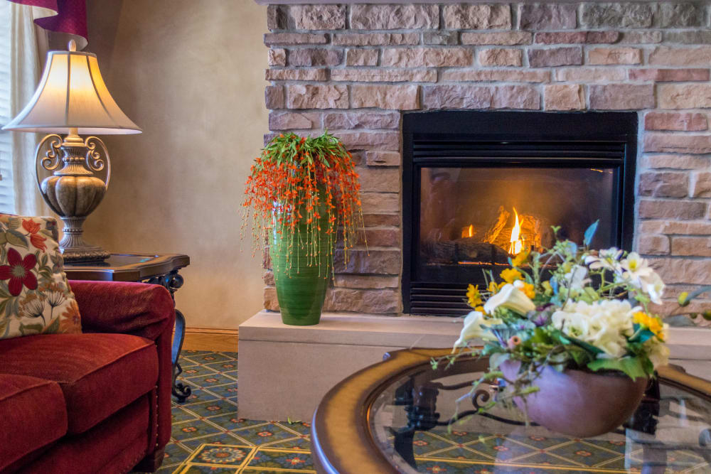 Seating area next to a fireplace at Applewood Pointe Maple Grove in Maple Grove, Minnesota.