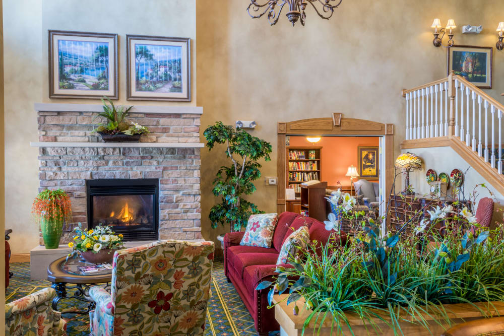 Lounge with a fireplace at Applewood Pointe Maple Grove in Maple Grove, Minnesota.