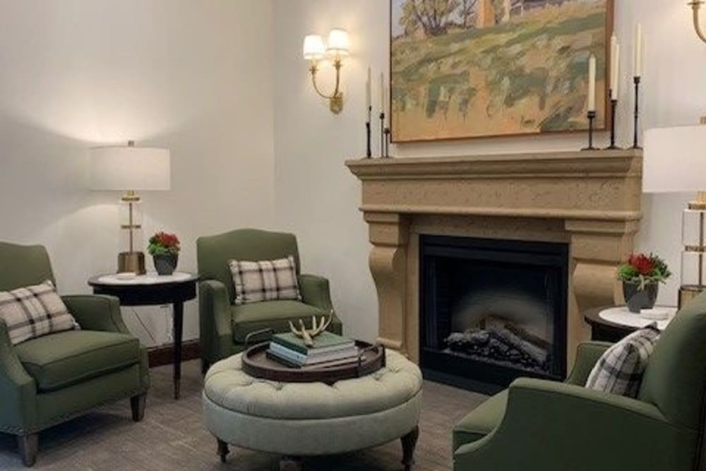 Living room area with fireplace at Seven Hills Senior Living