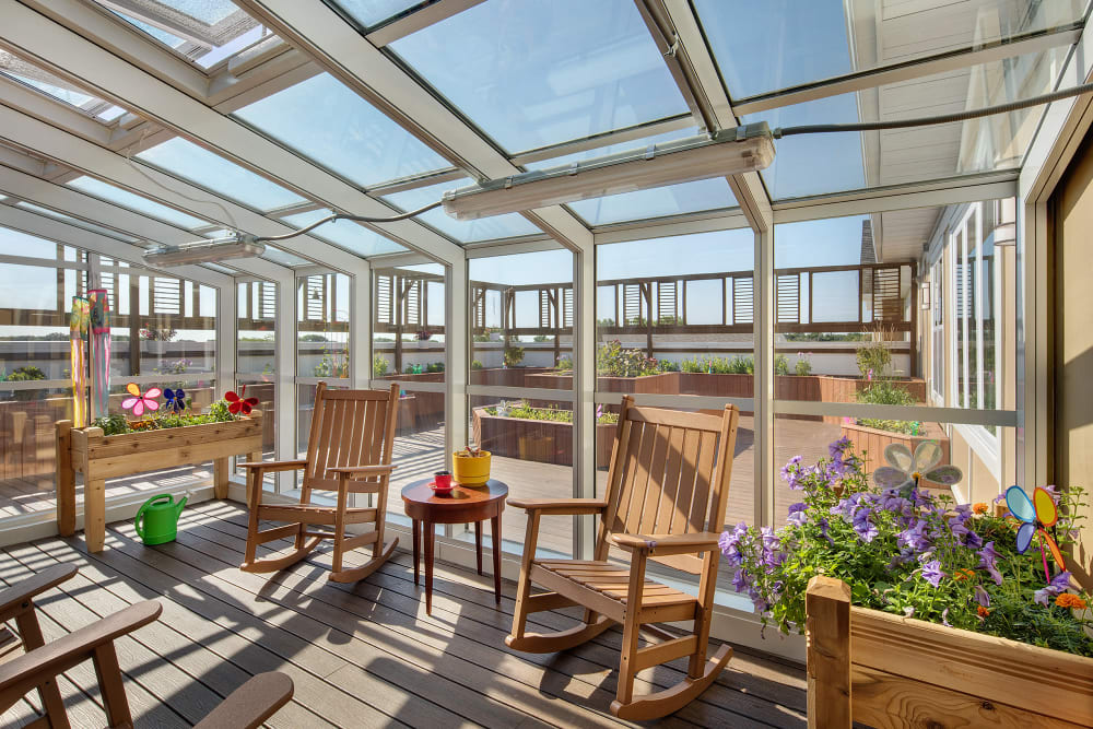 Sunroom and garden at Anthology of Grayslake in Grayslake, Illinois.