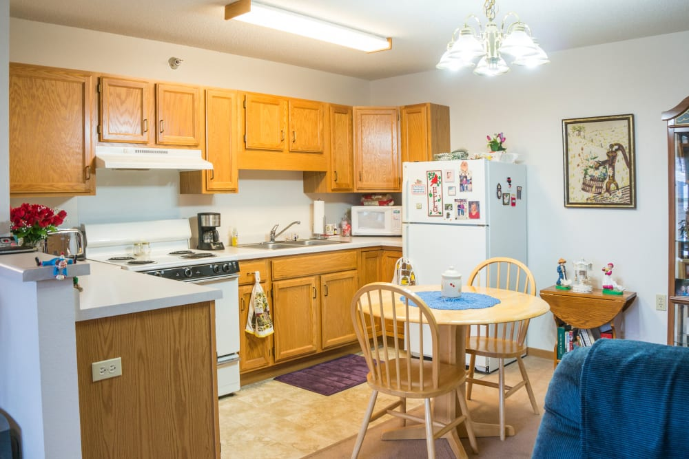 Open floor plans with a kitchen at Meadow Lakes Senior Living in Rochester, Minnesota.