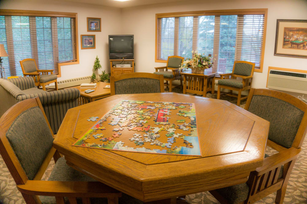 Activity room with jigsaw puzzle at Meadow Lakes Senior Living in Rochester, Minnesota.