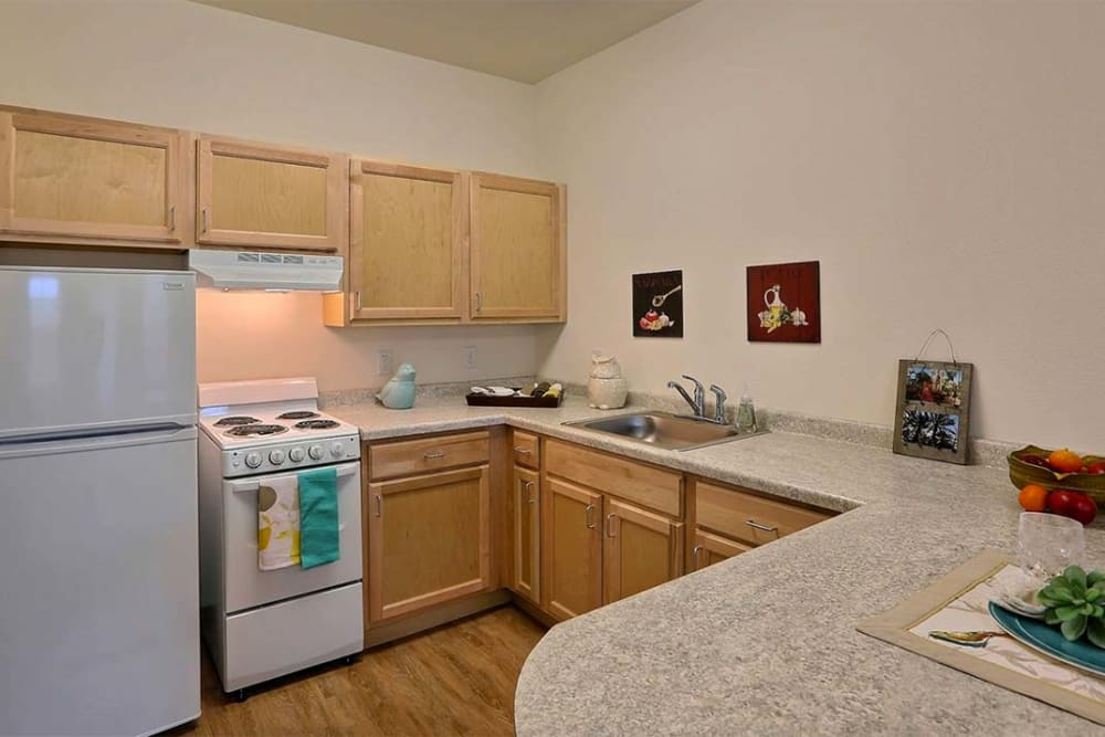 Open floor plans with a full kitchen at Milestone Senior Living Cross Plains in Cross Plains, Wisconsin.