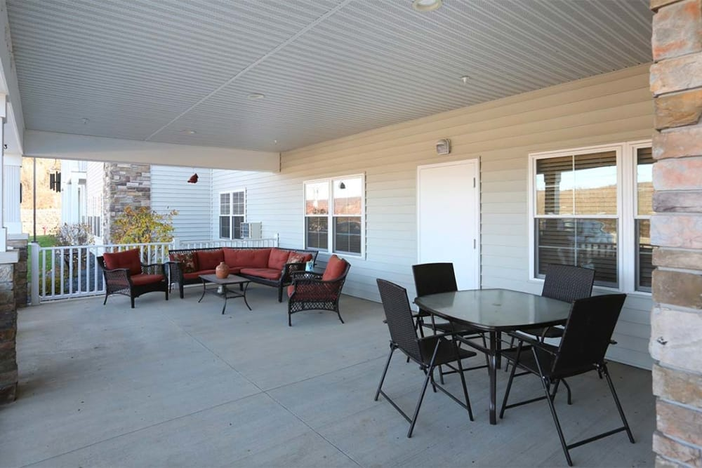 Outdoor porch with patio seating at Milestone Senior Living in Cross Plains, Wisconsin.