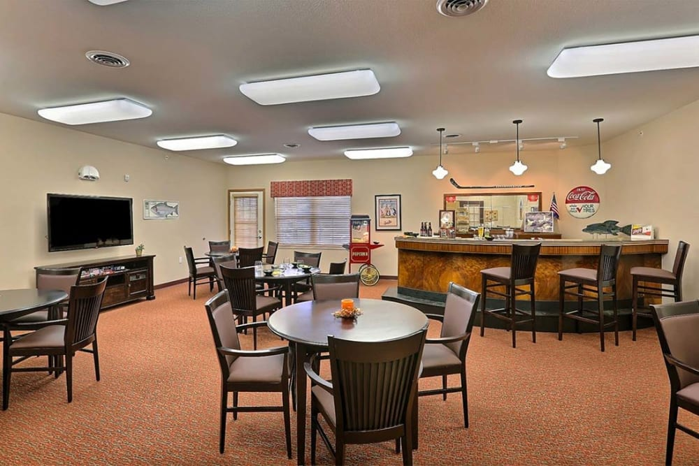Resident game room with snack bar at Milestone Senior Living in Cross Plains, Wisconsin.