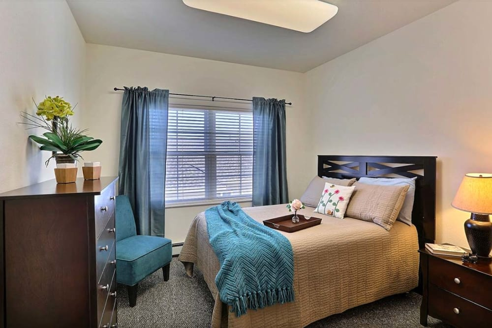 Spacious private resident bedroom at Milestone Senior Living in Cross Plains, Wisconsin.