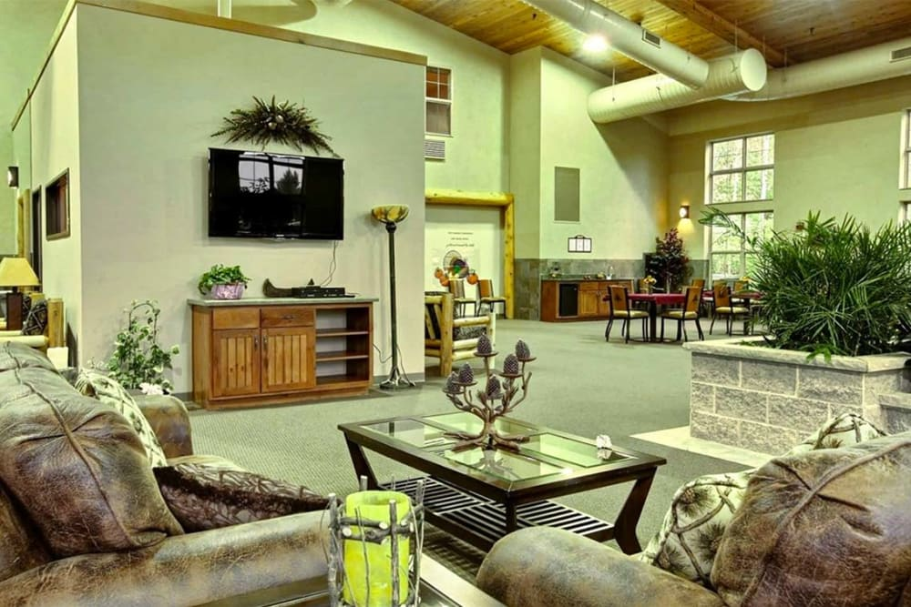 Resident TV lounge with comfortable seating at Milestone Senior Living in Eagle River, Wisconsin.