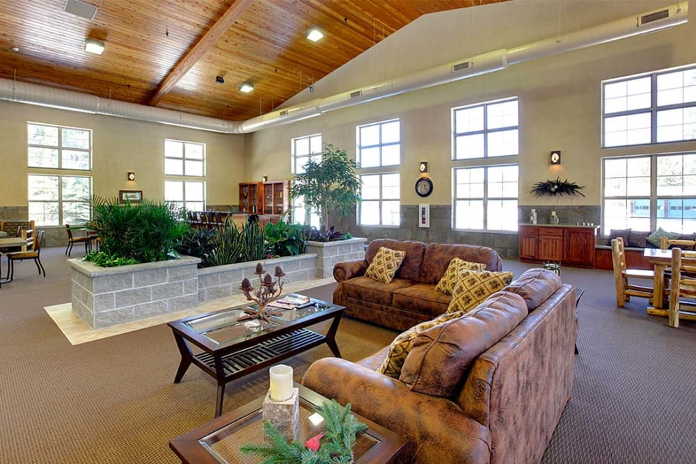 Comfortable lounge seating with vaulted ceilings at Milestone Senior Living Eagle River in Eagle River, Wisconsin.