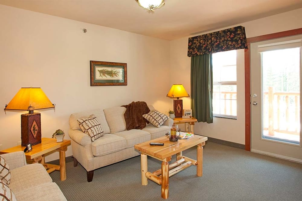 Resident living room with picture windows at Milestone Senior Living in Eagle River, Wisconsin.