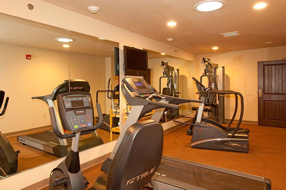 Complete fitness room with equipment at Milestone Senior Living in Eagle River, Wisconsin.