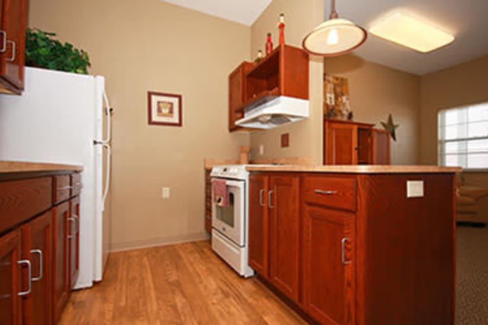 Open floor plans with a kitchen at Milestone Senior Living in Faribault, Minnesota.