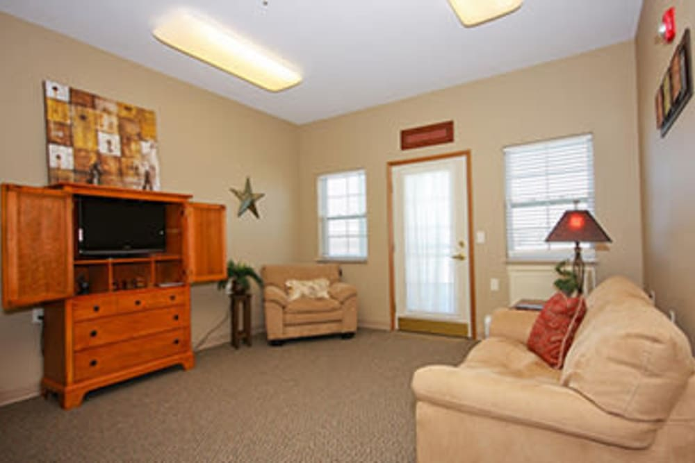 Resident living room with large windows at Milestone Senior Living in Faribault, Minnesota.