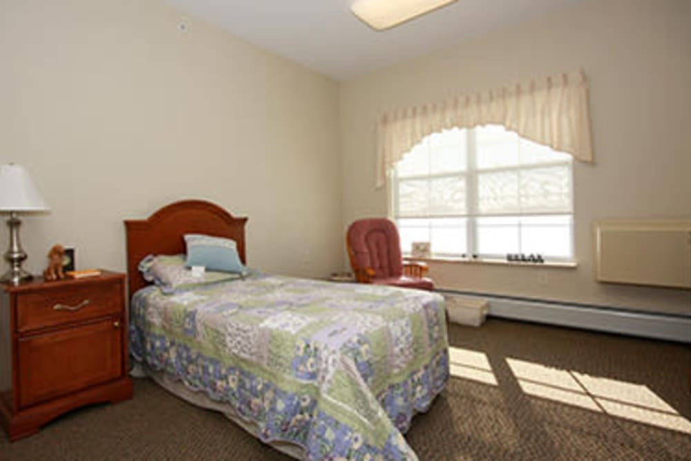 Resident bedroom at Milestone Senior Living in Faribault, Minnesota.