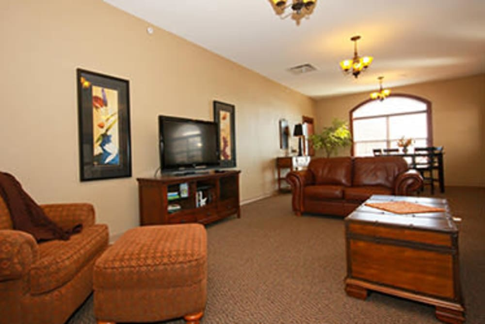 Club room with TV and puzzle at Milestone Senior Living in Faribault, Minnesota.