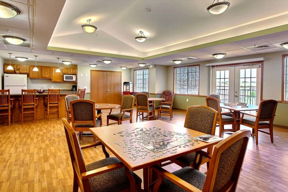 Activity room with games and a kitchenette at Milestone Senior Living in Hillsboro, Wisconsin.