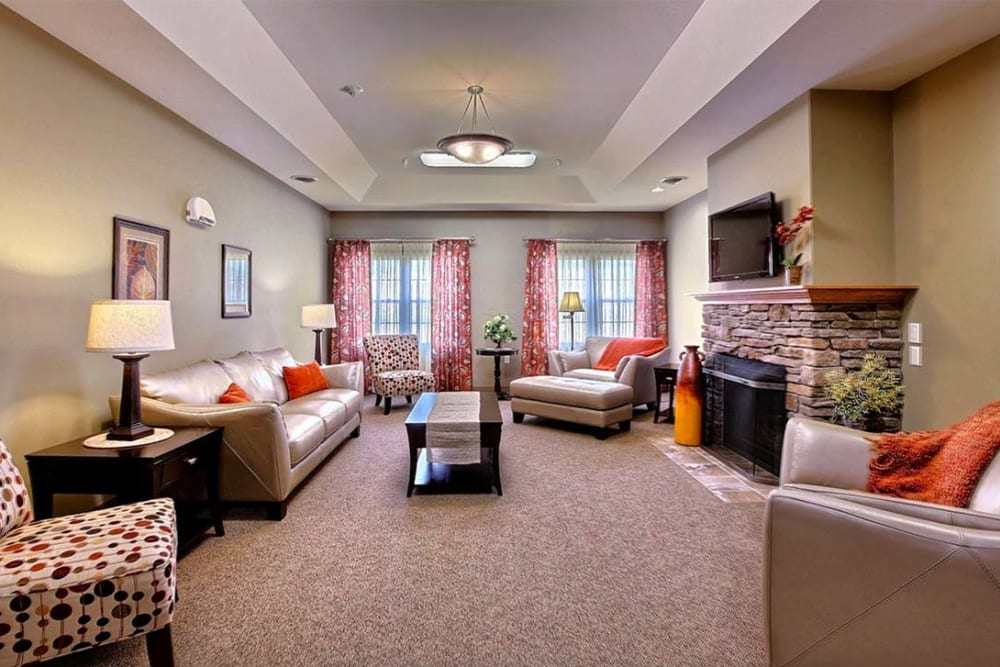 TV lounge with fireplace at Milestone Senior Living in Hillsboro, Wisconsin.