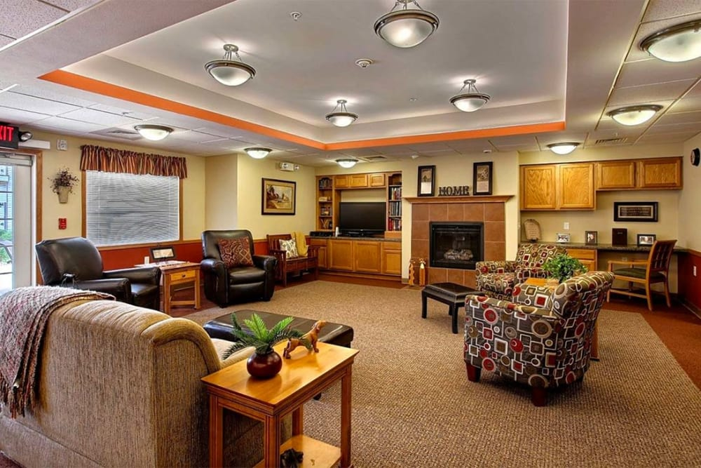 Comfortable lounge  with a fireplace at Milestone Senior Living in Hillsboro, Wisconsin.