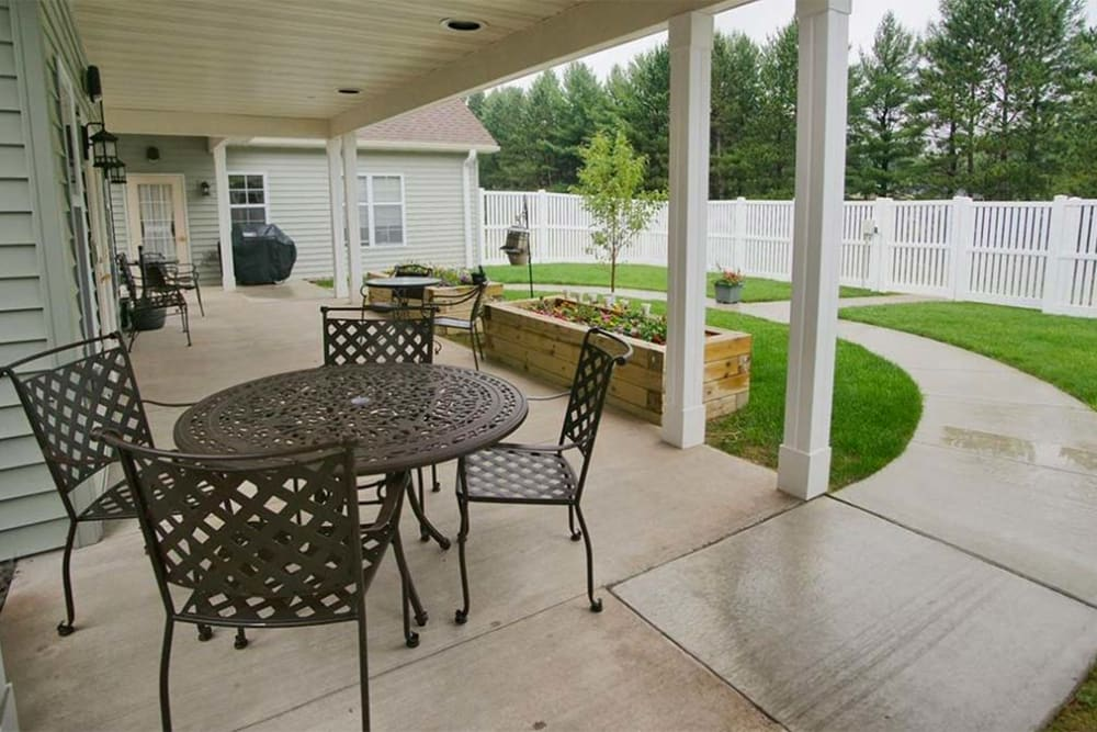 Walking path and patio seating at Milestone Senior Living in Rhinelander, Wisconsin.