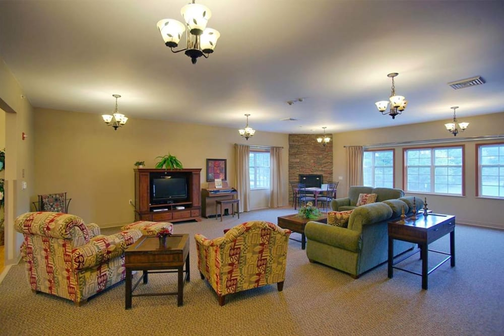 Community room with TV and large windows at Milestone Senior Living in Rhinelander, Wisconsin.